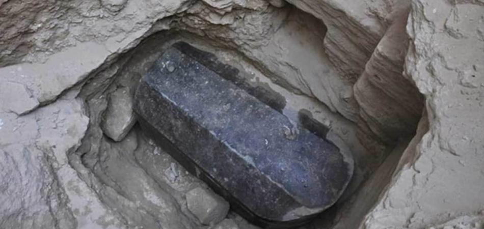Mystery of Alexandria's largest coffin: Archaeologists unearth 8.6-foot-long sarcophagus buried in Egypt 2,000 years ago beside a massive stone head